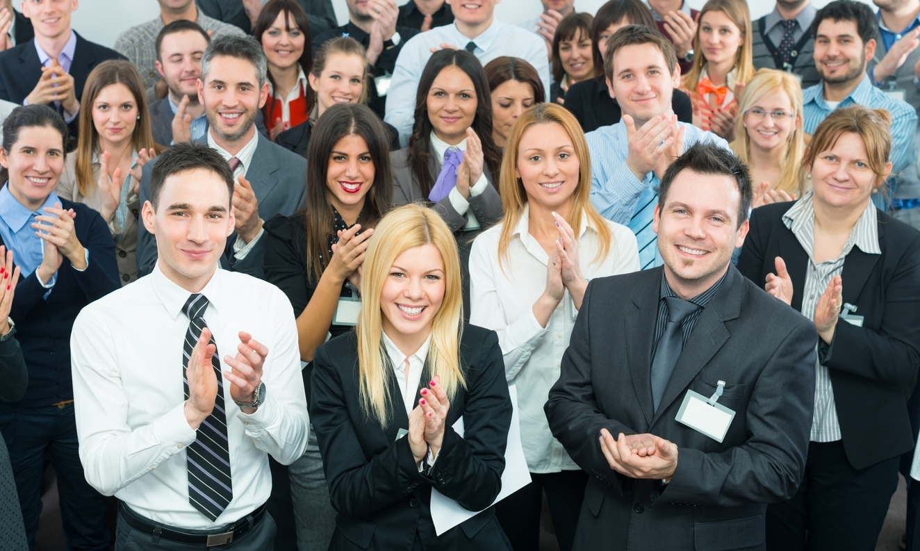 Young Business People Applaud At The Seminar Or Conference.
