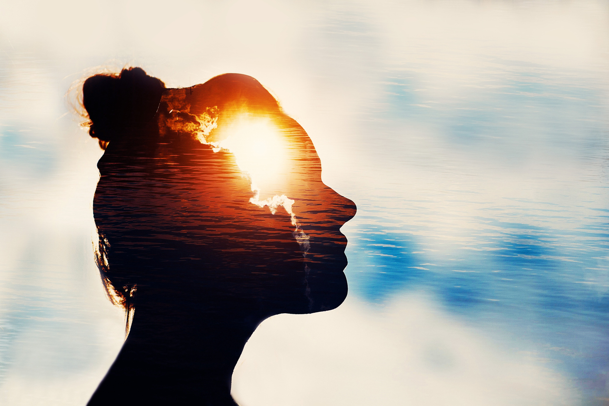 A Woman Looking At The Sky With An Overlay Of Clouds In Her Head; Demonstrates The Concept Of Inspiration